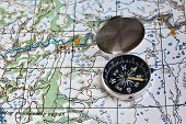 image of compass  - Geographical map and a compass. Photo magnetic compass located on a topographic map.