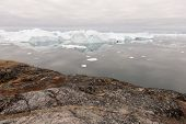 picture of arctic landscape  - Arctic landscape in Greenland around Disko Island with icebergs ocean mountains and cloudscape - JPG