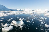 stock photo of iceberg  - Beautiful Icebergs in Disko Bay Greenland around Ilulissat with blue sky - JPG