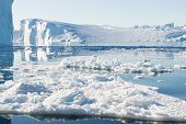 image of iceberg  - Beautiful Icebergs in Greenland with blue Sky - JPG