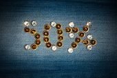 picture of fifties  - Fifty percent made from crystals on jeans fabric as background - JPG
