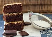 stock photo of brownie  - Chocolate brownie cake with coconut - JPG