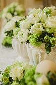 stock photo of marriage decoration  - Wedding table decoration, wedding setting, wedding flowers on table, shallow depth of field.