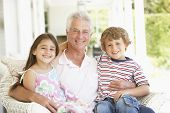 pic of grandfather  - Grandfather With Grandchildren At Home - JPG