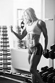 stock photo of muscle strain  - Black and white photo of a strong woman - JPG