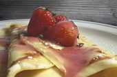 picture of crepes  - Homemade Crepes with fresh strawberries on top - JPG