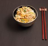 image of rice noodles  - Vietnamese vermicelli chicken and rice noodles soup pho on a black background - JPG