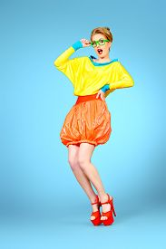picture of shot glasses  - Full length portrait of a glamorous fashion model posing in vivid colourful clothes and glasses - JPG
