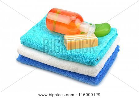 Towel, soap, shampoo isolated on white