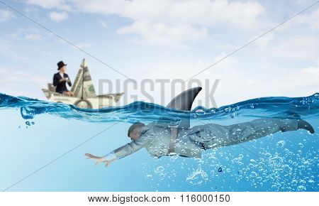 Businesswoman in boat made of dollar banknote