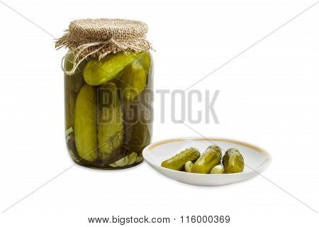 Pickled Cucumbers In Glass Jar And On A Saucer