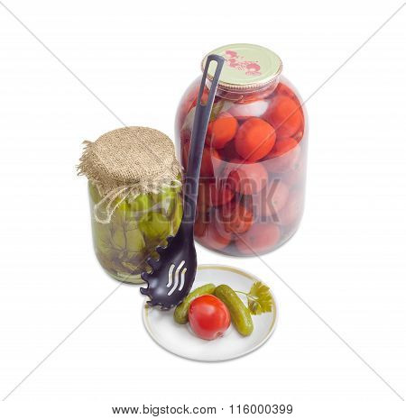 Pickled Cucumbers And Tomato On Saucer And In Glass Jars