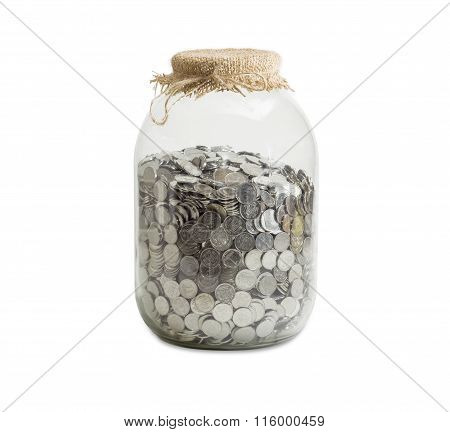 Coins In Jar On A Light Background