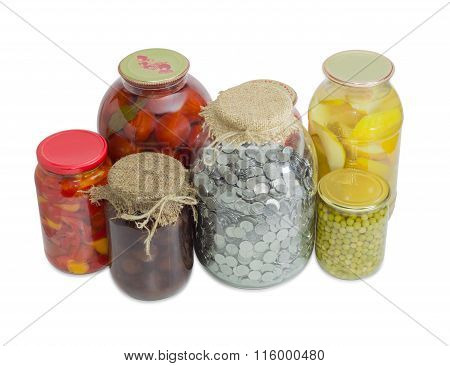 Jar With Coins Among Home Canned Fruit And Canned Vegetable