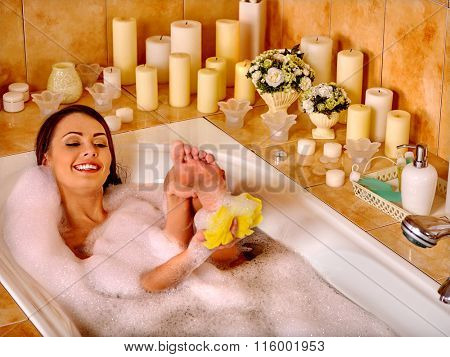 Woman relaxing in hot water at home luxury bath.