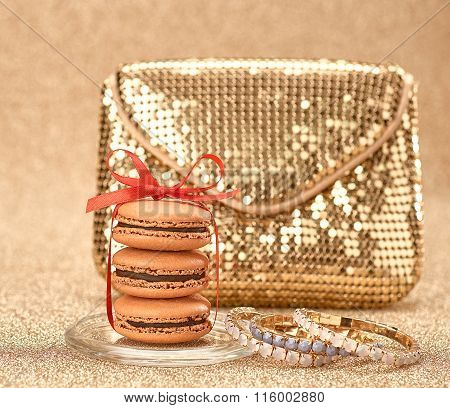 Macarons. Luxury shiny  handbag gold.Vintage,bokeh