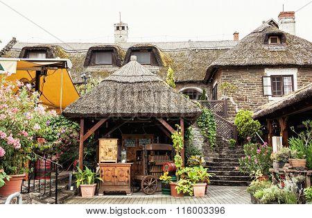 Garden Restaurant With Thatch In Hungarian Village, Tourist Destination