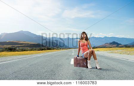 Pretty brunette retro hitchhiker