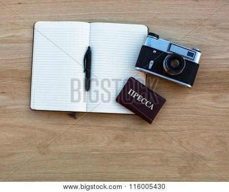 Russian press card, camera and Notepad with pen.