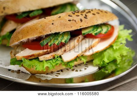 Chicken and salad whole wheat baguette.