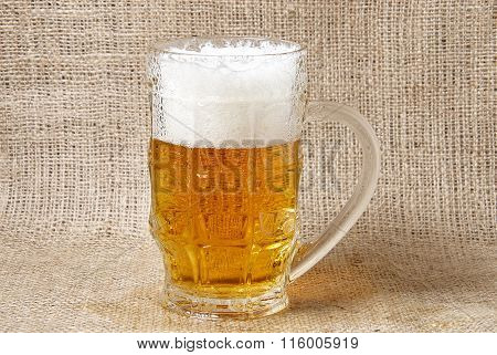 Glass Of  Beer On A Burlap Background
