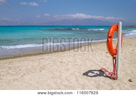 Chrisi (Chrysi) island white beach with red  life buoy in foreground, Crete, Greece. One of the most beautiful uninhabited island of Greece.