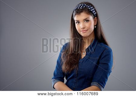 Portrait of attractive young woman looking at camera.