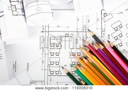 Crayons on blueprint
