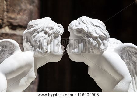 White Plaster Figurines Kissing Cupids, Close Up
