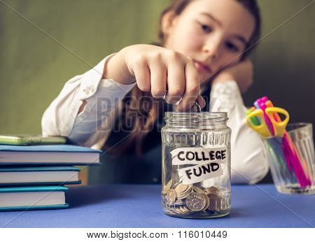 Paid education. Concept photo. Girl puts a coin in a piggy bank.