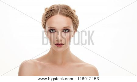 Closeup beauty portrait of young cute blonde woman with adorable makeup posing with bare shoulders o