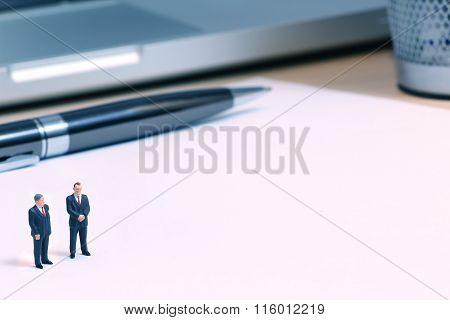 Tiny Businessdolls on blank page