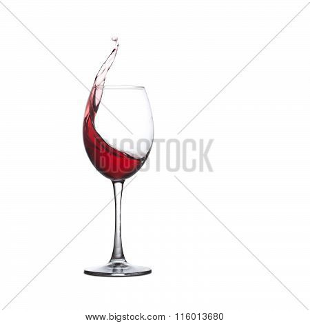 Red wine glass. Splashing alcohol drink, white background. copy space.
