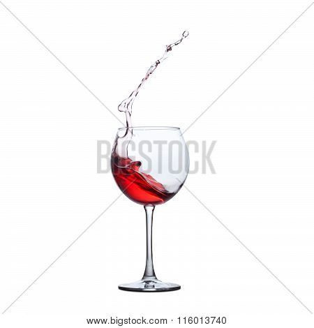 Red wine splash. splashing in crystal wineglass. white background.copy space