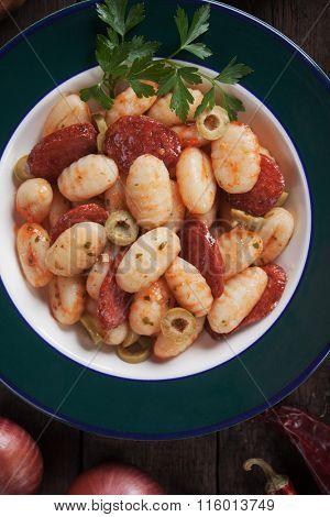 Gnocchi di patata, italian potato noodles with sausage and tomato sauce