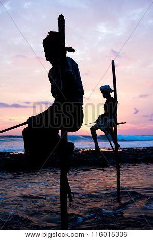 Stilt fisherman on a beach in Koggala, Sri Lanka