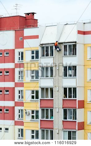 Industrial Climber Performs Sealing Of Interpanel Junctions Of Building