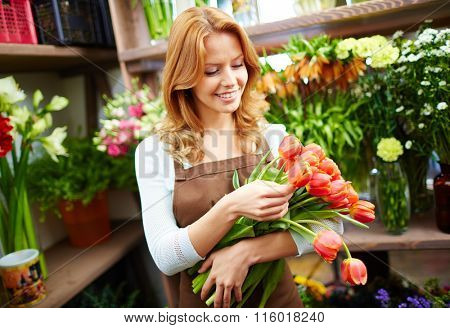 Florist with bunch of fresh tulips