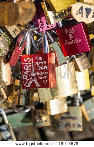 Paris France - Pont des Arts. Love padlocks on the bridge. Passerelle des Arts is a pedestrian bridge in Paris which crosses the River Seine