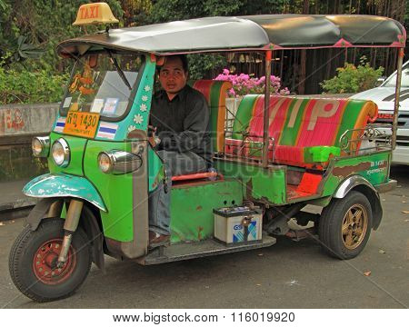 man is driving tuk-tuk in Bangkok, Thailand