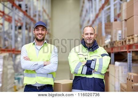 men in uniform with boxes at warehouse