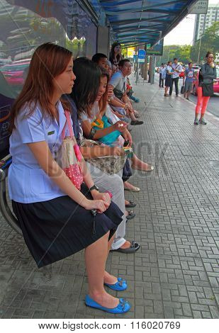 people are waiting for transport at bus stop