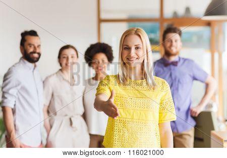 woman making handshake over creative office team