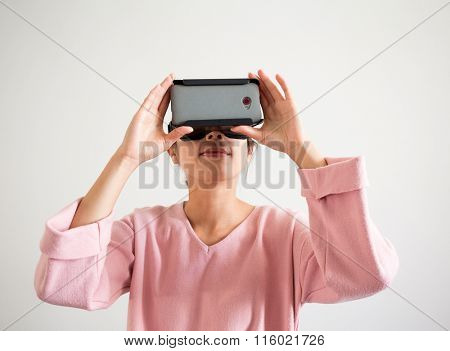 Woman watching though virtual reality device