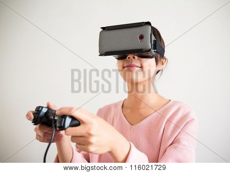 Asian Woman play game with virtual reality device