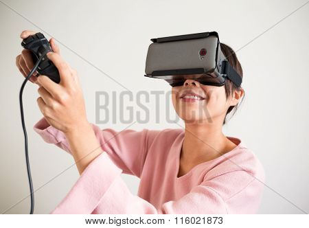 Excited Woman play game with virtual reality device