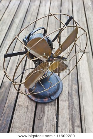 Seasoned Decking With An Old Fan