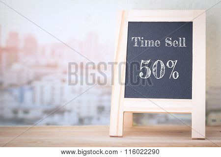 Concept Time Sell 50% message on wood boards