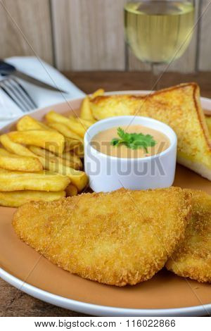 Crumbed Fish And Chips With Glass Of White Wine