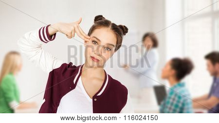 bored student girl making finger gun gesture